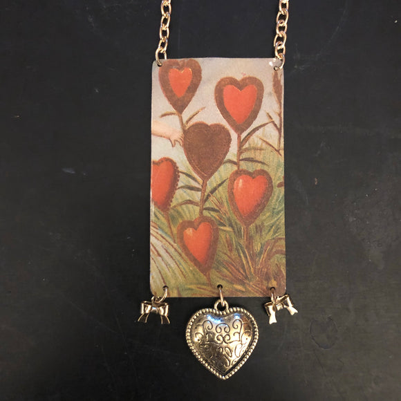 Field of Hearts Tin Necklace with Heart and Bows