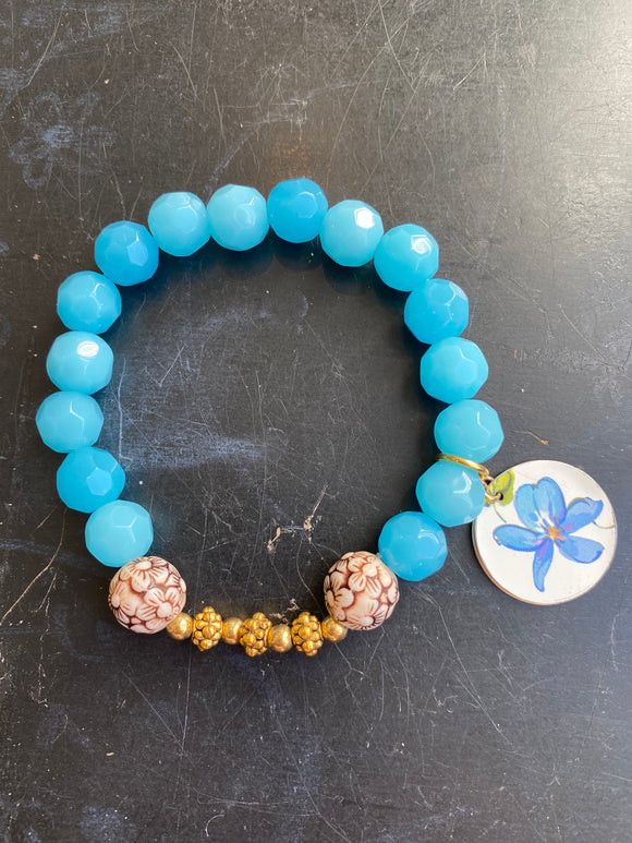 Bright Blue Glass Beads with Carved Wood Tin Charm Bracelet