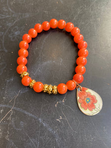 Orange Glass and Gold Bead and Floral Tin Charm Bracelet
