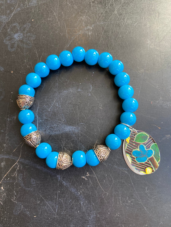Bright Blue Glass Beads with Antiqued Silver Tin Charm Bracelet