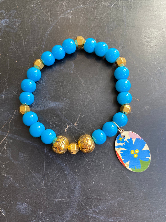 Bright Blue Bead with Silver Bead and Floral Tin Charm Bracelet