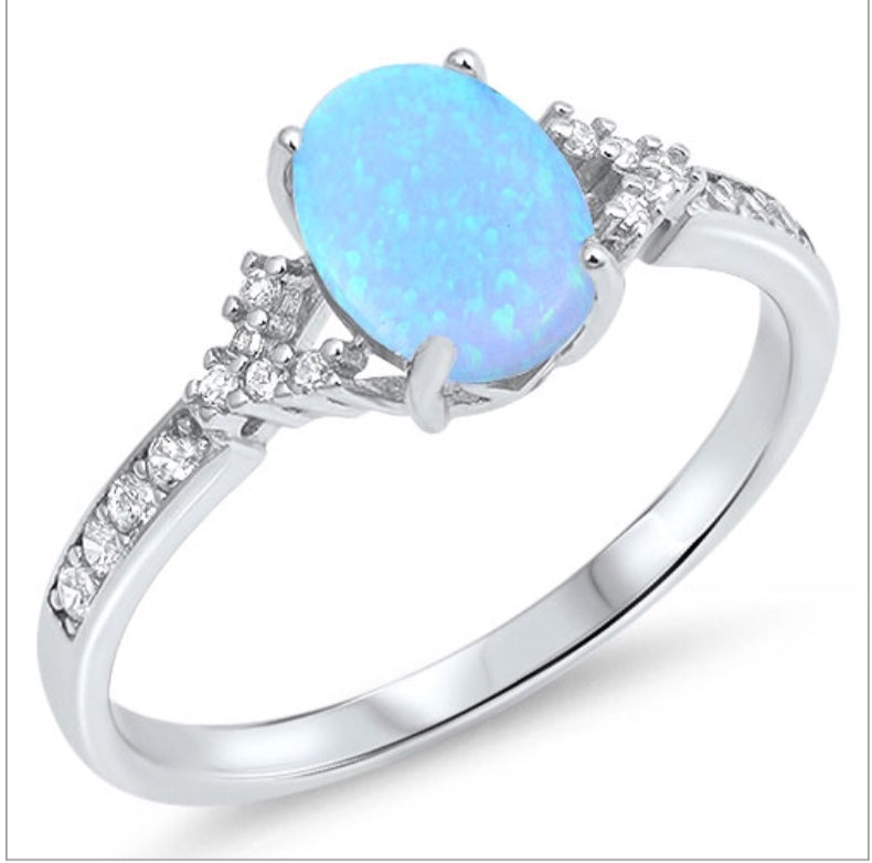 Blue oval Opal stone with Clear cz channel set stones