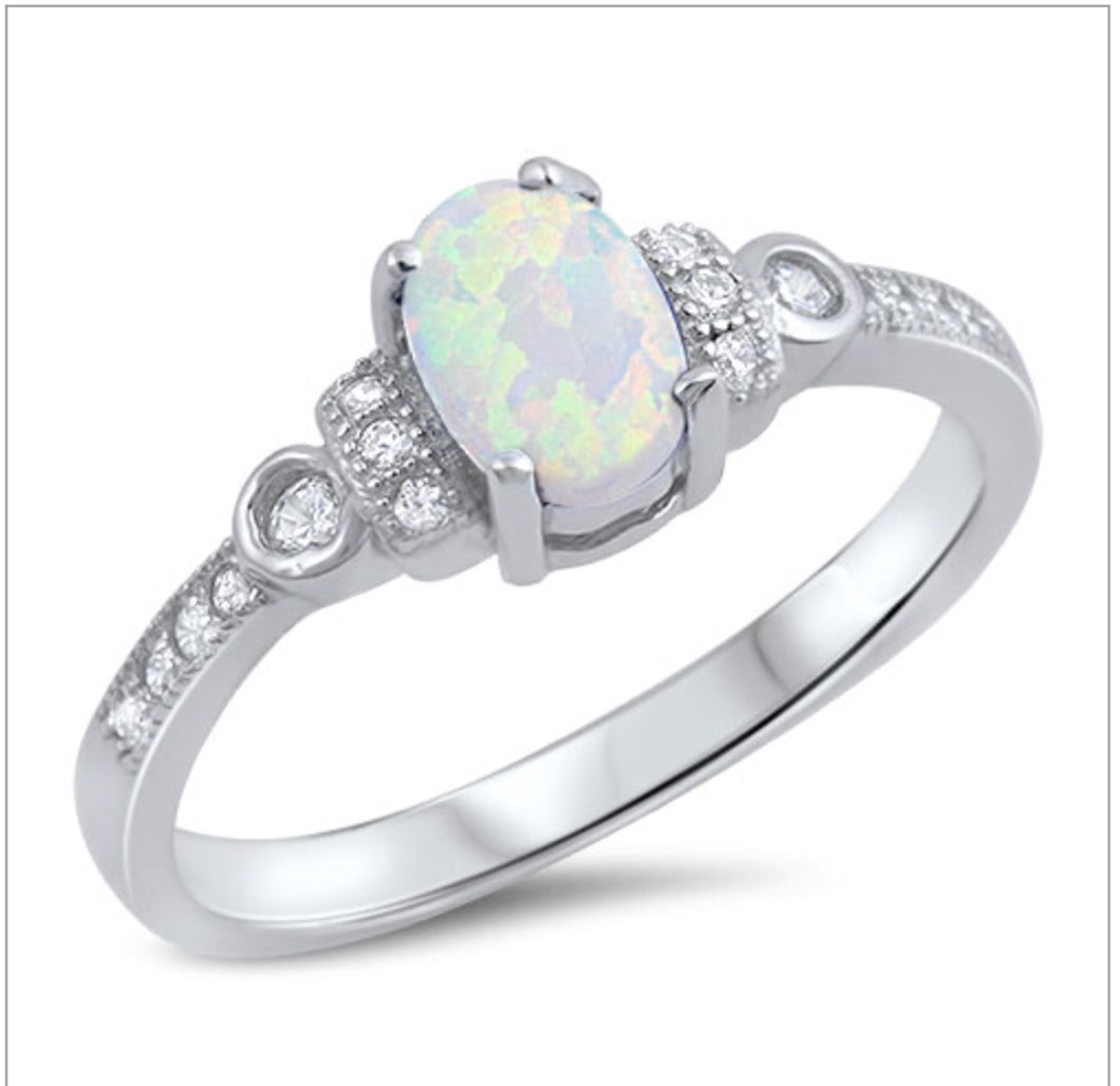 Oval Opal with channel set stones