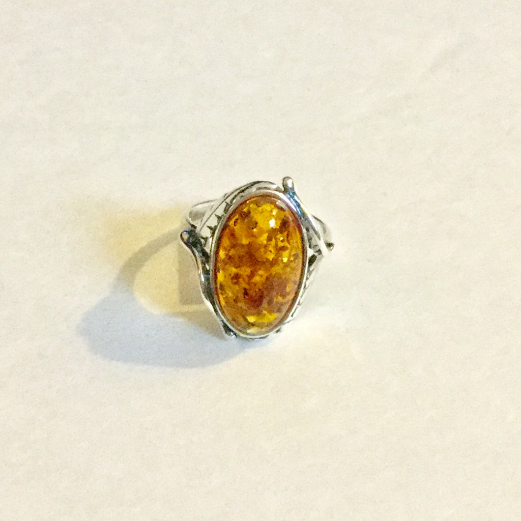 Large Amber piece Set in Leaf detail Ring