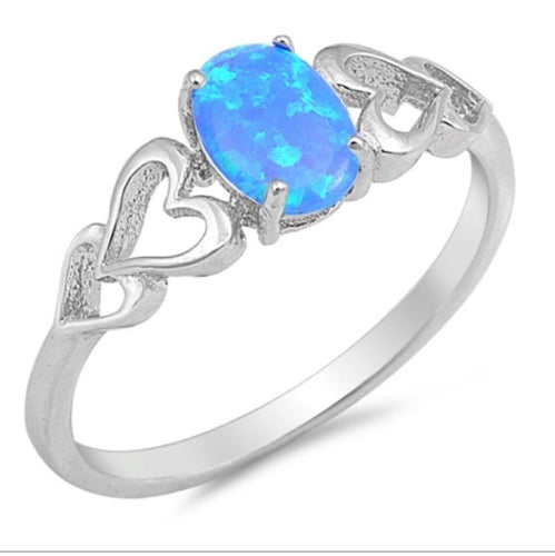 Oval cut Blue Opal and Heart ring