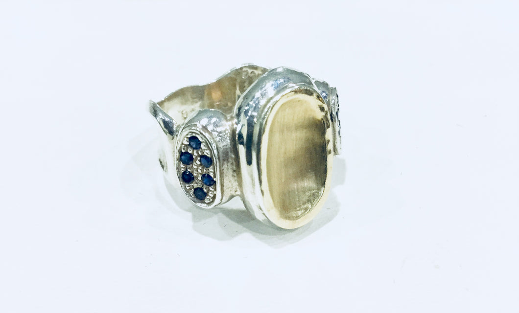 Sterling Silver ring with blue Sapphire and 10K gold