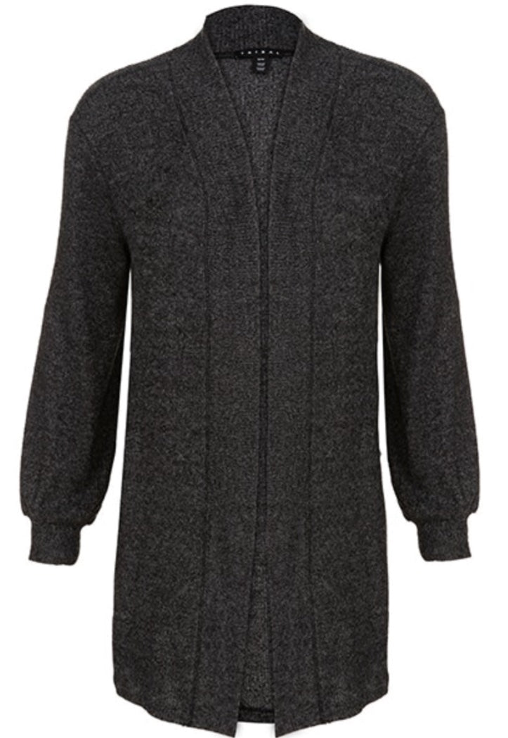 Soft, cozy cardigan sweater with pocket and ribbed texture, finished with a wide trim detail. This is a must have for the closet. Perfect for the office or curling up in a chair with a good book. You deserve it