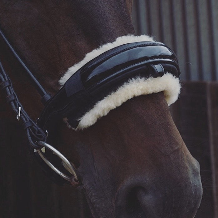 Close up photo of horse wearing Caboose Equestrian Sheepskin Noseband Cover