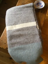 Grey, blue and white blanket
