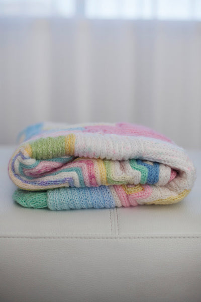 baby cot blanket made of recycled wool scraps. All pastel colors. French knitted art