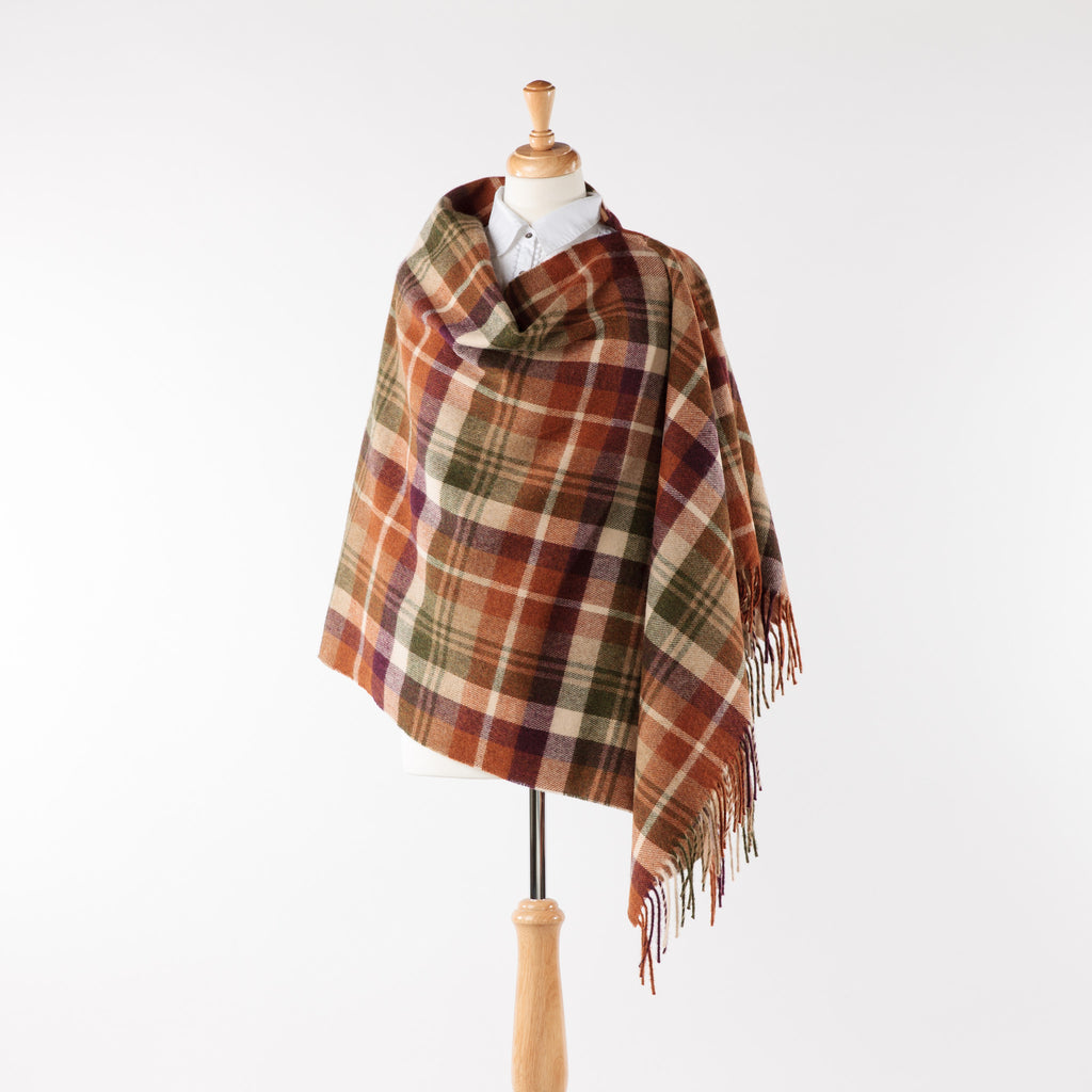 Soft merino lambswool tonal brown and orange fringed poncho