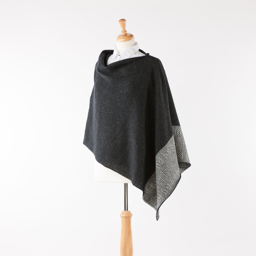 Soft merino lambswool poncho with geometric design in charcoal grey and ash