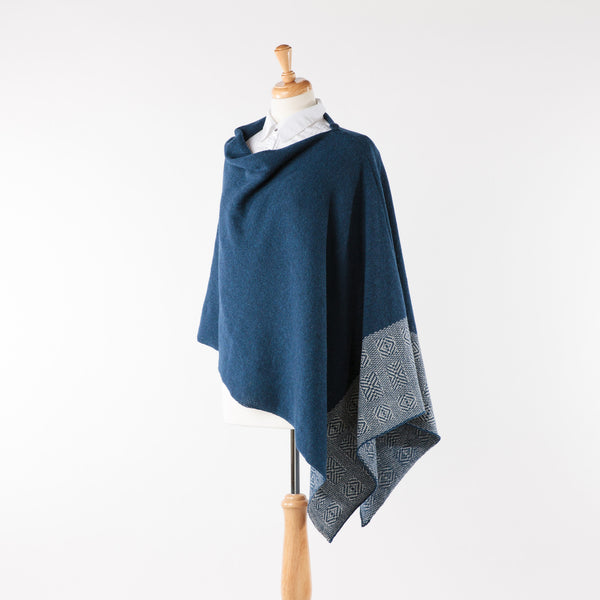 Soft merino lambswool poncho with geometric design in navy and pearl grey
