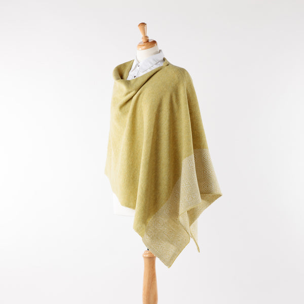 Soft merino lambswool poncho with geometric design in pistachio and silver