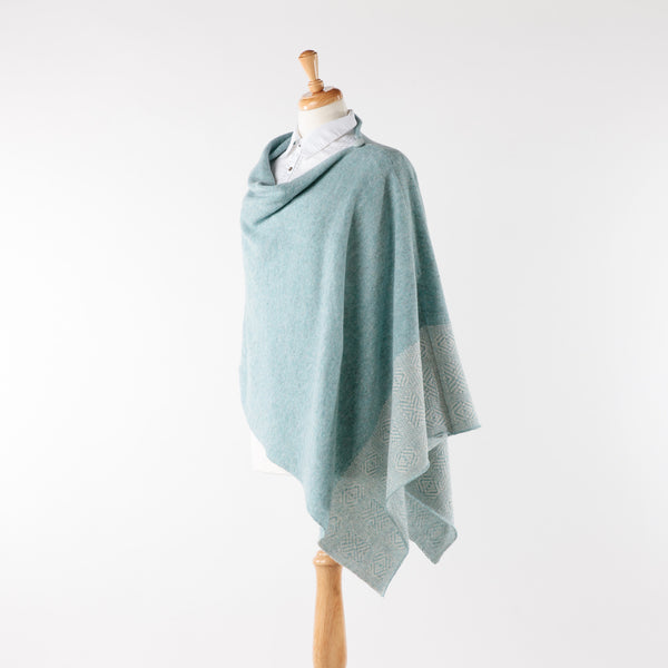 Soft merino lambswool poncho with geometric design in opal and silver
