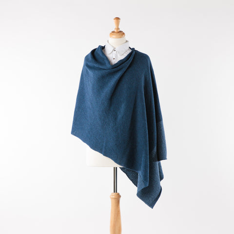 Soft merino lambswool poncho with geometric design in navy and denim blue