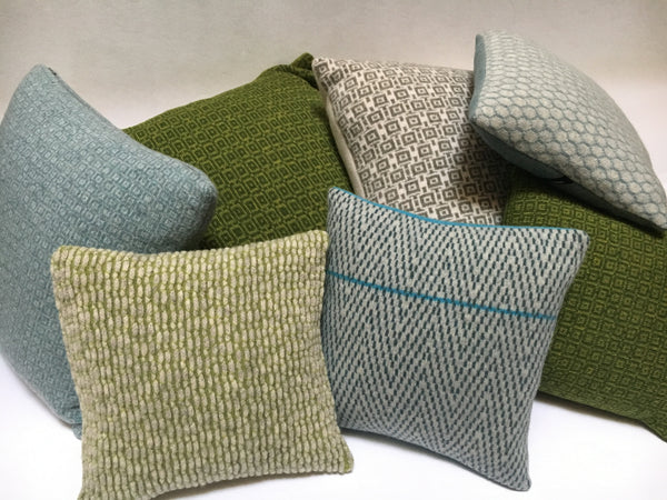 collection of knitted merino lambswool cushions