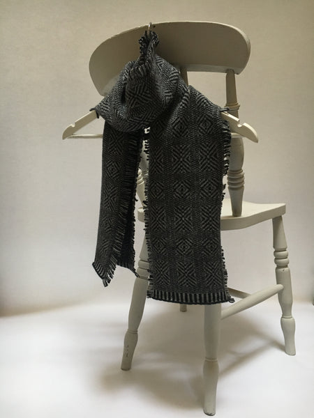 scarf with a charcoal grey geometric pattern