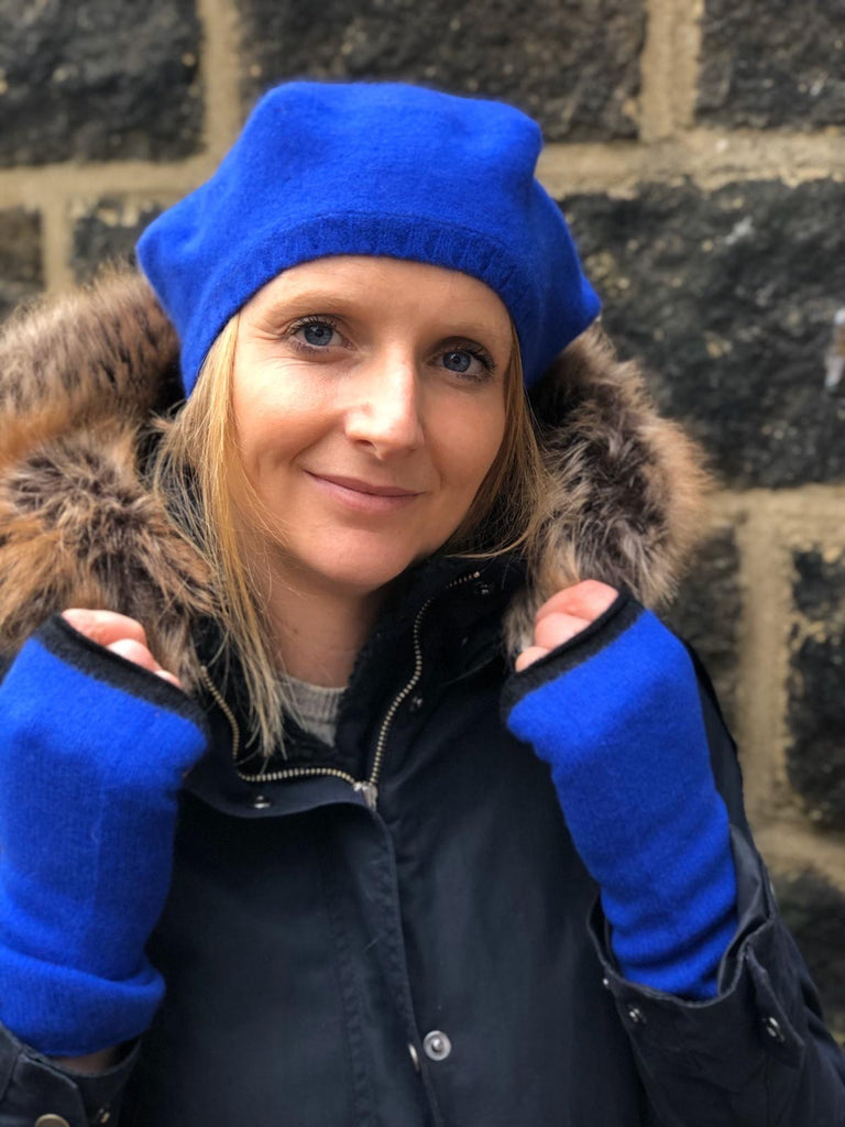 lady wear cobalt blue lambswool beret and matching wrist warmers