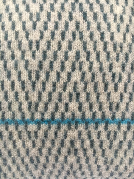 aqua blue line across ash grey/air force blue herringbone design