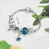 Music Notes Blue Star Charm Bracelet