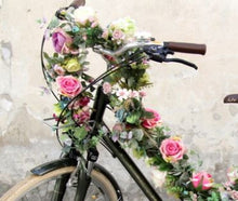 garland with roses to decorate bike frame