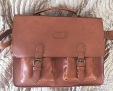 tan satchel with clip on system