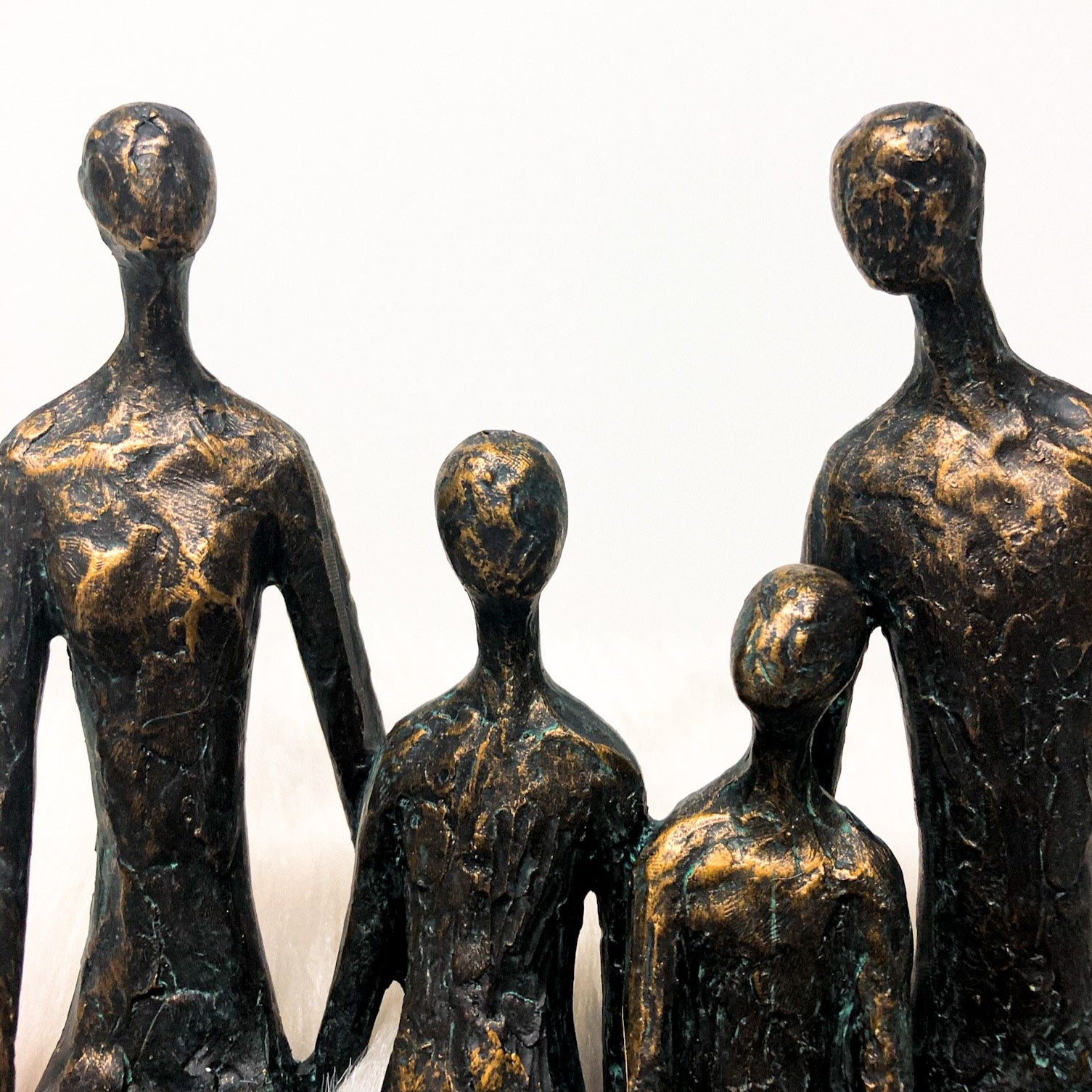 Sitting family of 4 shelf sculpture