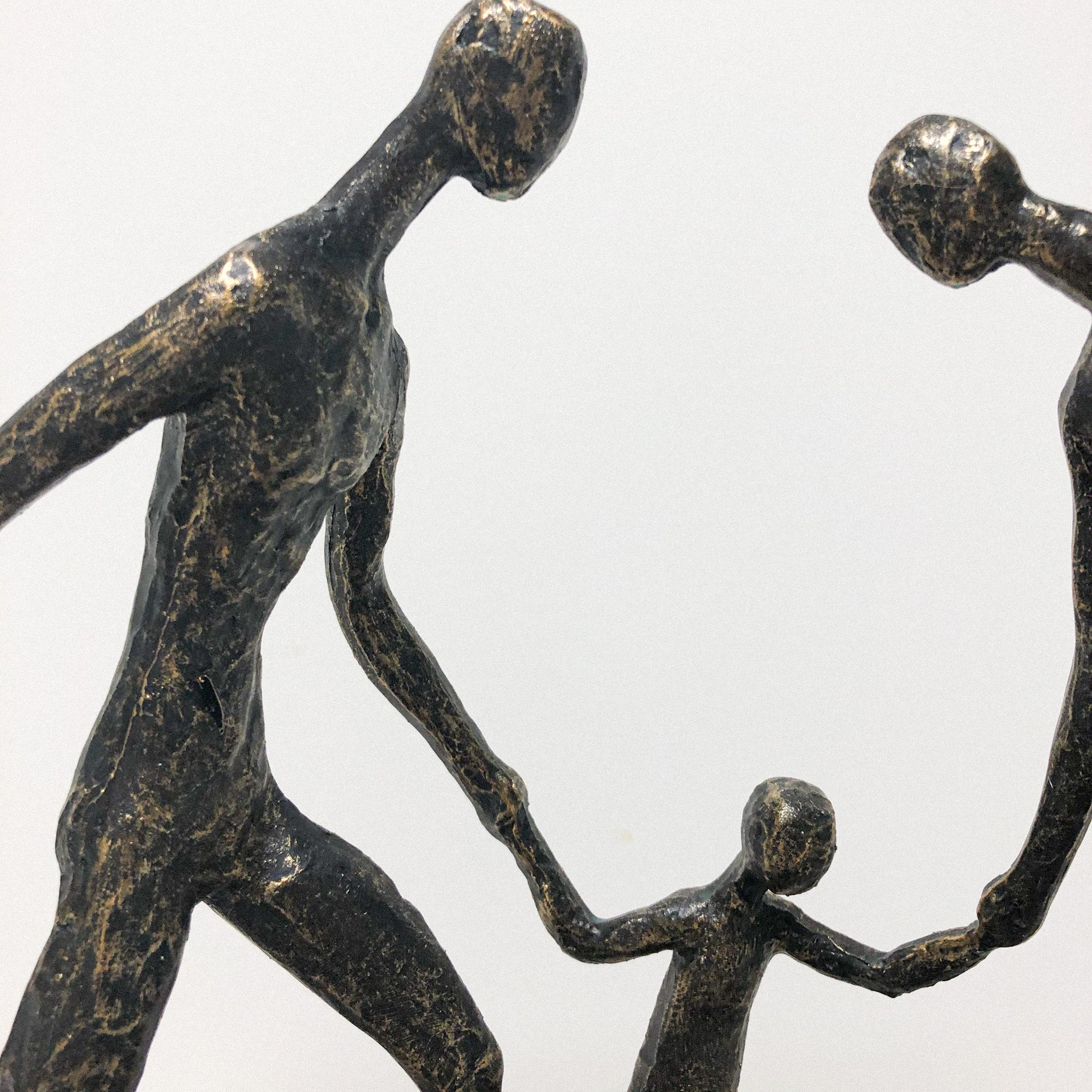 Family Of Three Holding Hands Sculpture