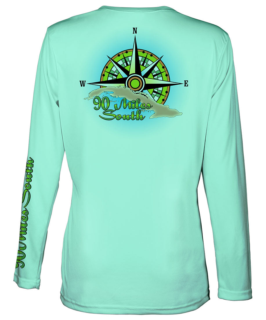 Ladies V-Neck | back view of a sea foam green long sleeve performance v-neck t-shirt depicting a green compass rose artwork and outline of the island of Cuba