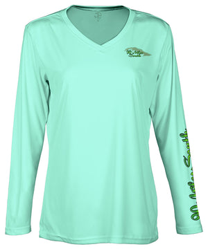 "front view of a ladies sea foam green v-neck performance shirt with 90 Miles South Island left chest logo and right sleeve copy saying ""90 Miles South"""