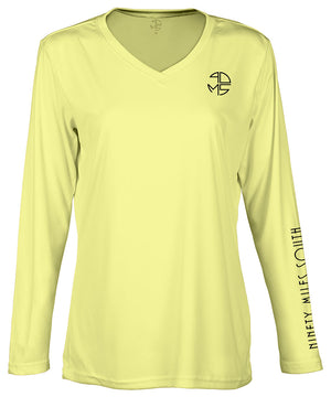 "front view of a ladies canary yellow v-neck performance shirt with 90 Miles South Round left chest logo and right sleeve copy saying ""90 Miles South"""