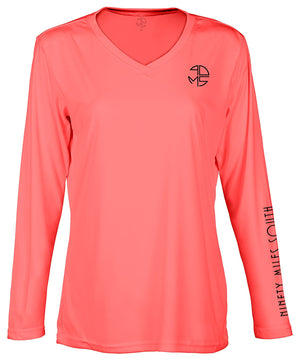 "front view of a ladies coral v-neck performance shirt with 90 Miles South Round left chest logo and right sleeve copy saying ""90 Miles South"""