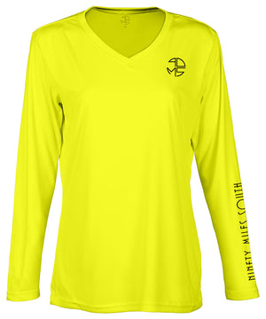 "front view of a ladies neon yellow v-neck performance shirt with 90 Miles South Round left chest logo and right sleeve copy saying ""90 Miles South"""