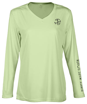 "front view of a ladies olive green v-neck performance shirt with 90 Miles South Round left chest logo and right sleeve copy saying ""90 Miles South"""