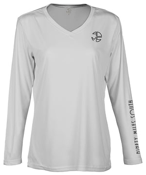 "front view of a ladies light silver v-neck performance shirt with 90 Miles South Round left chest logo and right sleeve copy saying ""90 Miles South"""
