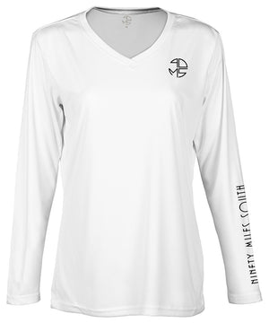 "front view of a ladies white v-neck performance shirt with 90 Miles South Round left chest logo and right sleeve copy saying ""90 Miles South"""