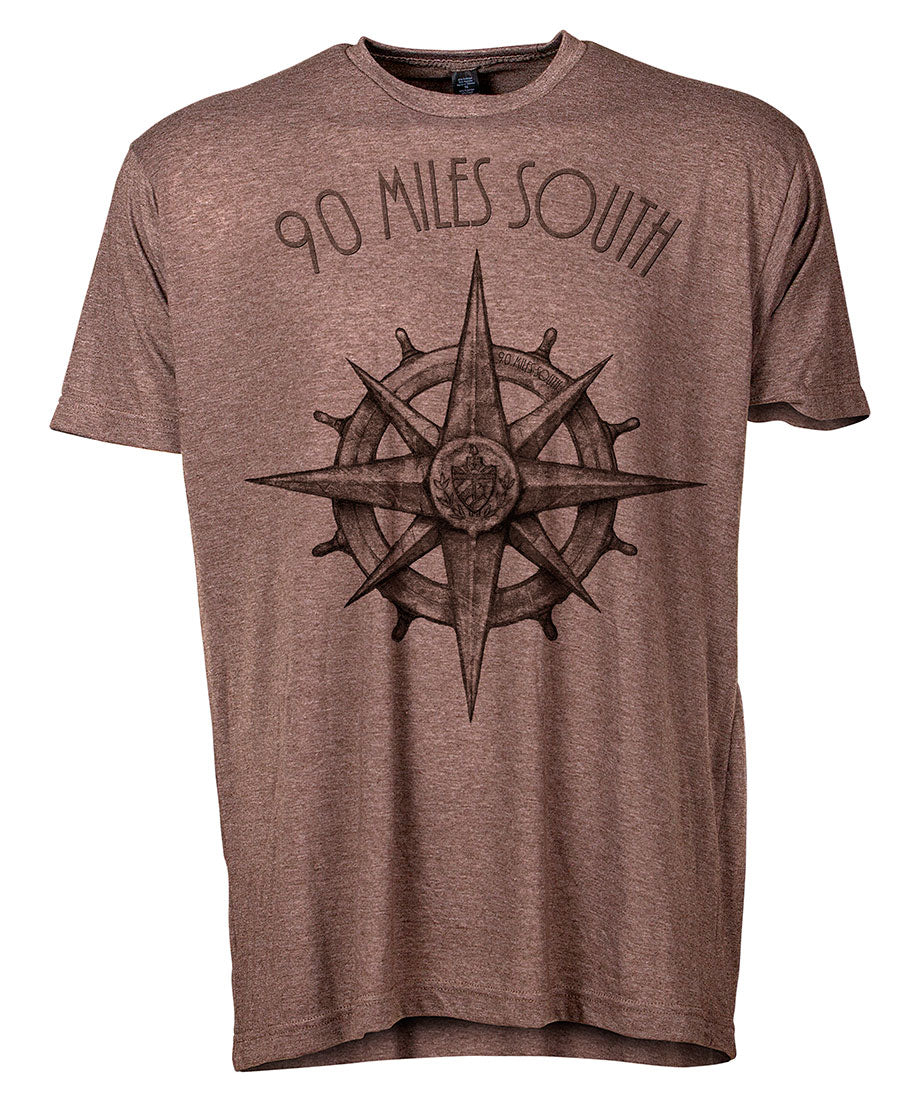 Front view of short sleeve heather brown tee shirt with dark brown artwork of 90 Miles South compass