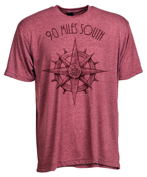 Front view of short sleeve heather burgundy tee shirt with dark burgundy artwork of 90 Miles South compass