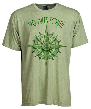 Front view of short sleeve heather green tee shirt with dark green artwork of 90 Miles South compass