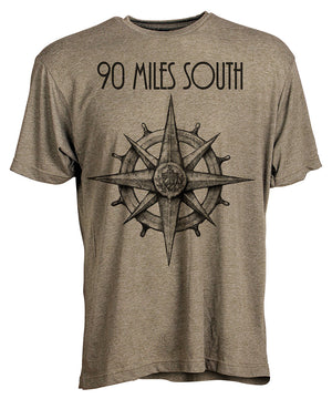 Front view of short sleeve military green tee shirt with black artwork of 90 Miles South compass