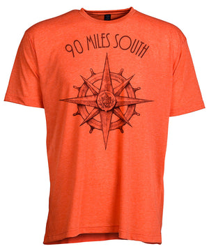 Front view of short sleeve heather orange tee shirt with black artwork of 90 Miles South compass