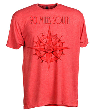 Front view of short sleeve heather red tee shirt with dark red artwork of 90 Miles South compass