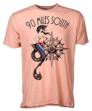 Front view of short sleeve peach tee shirt with black artwork of 90 Miles South Mermaid