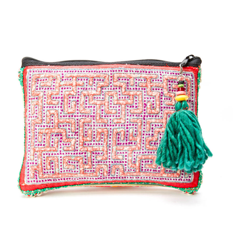 Chailony pink orange print make up bag with green yarn tassle