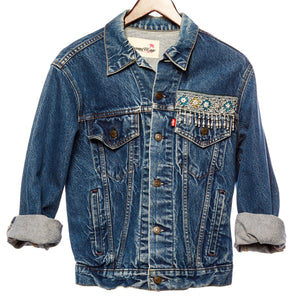 Ching Distressed Denim Jacket with Blue Teal Laos Silk, Burma Coin, and Hand Beaded Detail Front