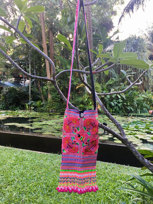 Lon Upcycled Pink Multi Color Black Bird Printed Festival Crossbody with Hand Beaded Detail and Mini Yarn Tassel Lifestyle