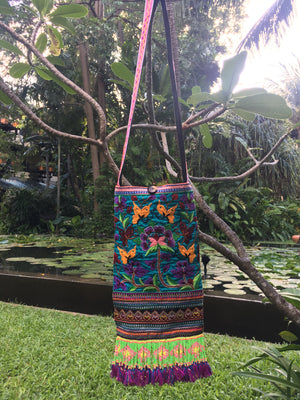 Thale Upcycled Blue Multi Color Printed Festival Crossbody with Hand Beaded Detail and Mini Yarn Tassel Lifestyle
