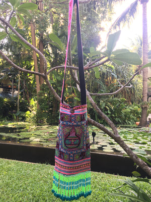 Phra Upcycled Purple Multi Color Printed Festival Crossbody with Hand Beaded and Mini Pom Pom Detail Lifestyle
