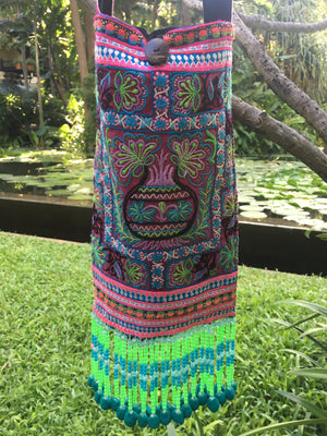 Phra Upcycled Purple Multi Color Printed Festival Crossbody with Hand Beaded and Mini Pom Pom Detail Close Up